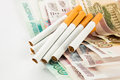 Money and group of cigarettes on white Stock Photography