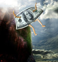 Money jumping from cliff Stock Photo