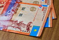 Money of kazakhstan large denominations for a wooden table Royalty Free Stock Photo