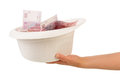 Money laundering with bowl in human hand Stock Images