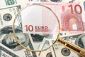 Money and magnifier Royalty Free Stock Photo