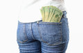 Money in my pocket a bunch of cash on a woman s jeans back Stock Photos