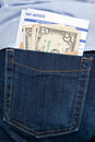 Money and payslip in back pocket. Royalty Free Stock Photo