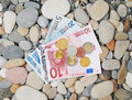 Money on a pebble beach lies the seashore Stock Photography