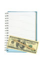 Money and pen over empty notebook Royalty Free Stock Photo