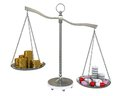 Money and pills in the gold balance scales Stock Photography