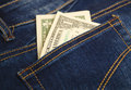 Money in the pocket of blue jeans Royalty Free Stock Photo