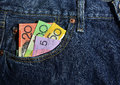 Money in the Pocket of New Jeans Royalty Free Stock Photo