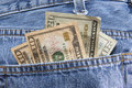 Money in pocket a wad of dollars the back of some jeans Royalty Free Stock Photography