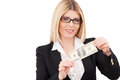 Money is a power confident mature businesswoman holding one hundred dollar bill and smiling while standing isolated on white Stock Photo