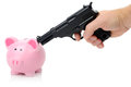 Money problems gun pointing at coin bank concept of Stock Photography