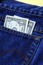 Money in the rear pocket of a blue jeans Royalty Free Stock Photo