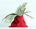 Money in the red bag on a light background Stock Photo
