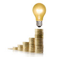 Money saved in different kinds of light bulbs a Stock Photo