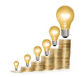 Money saved in different kinds of light bulbs a Stock Photography