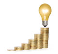 Money saved in different kinds of light bulbs a Royalty Free Stock Photography