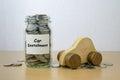 Money saving for car installment in the glass bottle Stock Photos