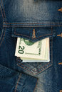 Money sticking out of jeans pocket Royalty Free Stock Photo