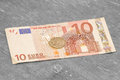 Money on the table ten euros per ruble Royalty Free Stock Images