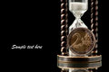 Money and time euro coin hourglass on black background studio shot Royalty Free Stock Photography