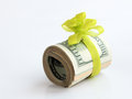 Money u s dollars banknotes with a green ribbon as a gift of Royalty Free Stock Image