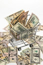 Money U.S. dollars with shopping basket Royalty Free Stock Photography