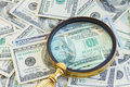 Money under magnifying glass pile of american dollars mangifying close up Royalty Free Stock Photography
