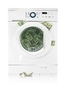 Money in washing machine on white background Royalty Free Stock Photo