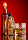 Money and whisky bottles composition bottle Royalty Free Stock Photography