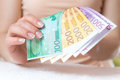Money in womens hands euro beautiful women s focus Stock Images