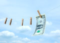 Money with wooden clothespin on clothes line Stock Photography