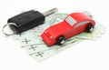 Money, wooden red toy car and key vehicle. White background Royalty Free Stock Photo
