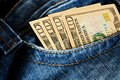 Money in your pocket ten dollar bills the of jeans Royalty Free Stock Photo