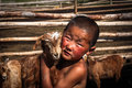 Mongolian boy a nomadic with his baby goat Stock Images
