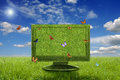 Monitor and butterflies green flying around it ecology concept Royalty Free Stock Photo