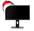 Monitor and Santa Claus hat Royalty Free Stock Image