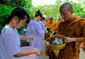 Monk in buddhism receiving food from people thailand Royalty Free Stock Photo