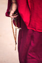 Monk with prayer beads in the hands of a Royalty Free Stock Image