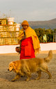 Monk speeching chiang rai thailand january v vajiramedhi for buddhism while his dog walk around in rai cherntawan meditation Stock Images