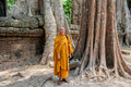 Monk at ta prohm siem reap cambodia – march buddhist posing built in th century temple was later the location for the Stock Photography