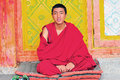 Monk in tibet knock a gong sangpi temple xiangcheng country sichuan Stock Image