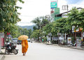 Monk walking in Pai, Thailand Stock Photo