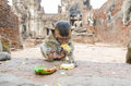 Monkey baby eating fruit in temple Stock Image