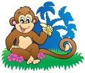 Monkey eating banana near palms Royalty Free Stock Photos