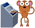 Monkey with money machine a happy cartoon using an automated teller Stock Photos