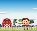 A monkey near the red barnhouse illustration of Stock Image