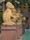 Monkey statues by the pool Stock Photo