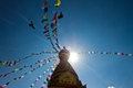 The monkey temple of kathmandu nepal s with prayer flags and flying birds Stock Image