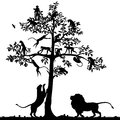 Monkeys and lions editable vector silhouette of in a tree a pair of below with all figures as separate objects Stock Photos