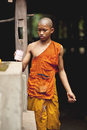 Monks in the angkor wat kampuchea is a country of belief buddhism a lot of young is one of them Stock Photos
